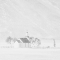 Small church in the snow storm