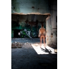 Woman in abandoned porcelain factory